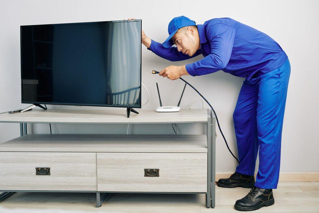 Repairman installing tv set
